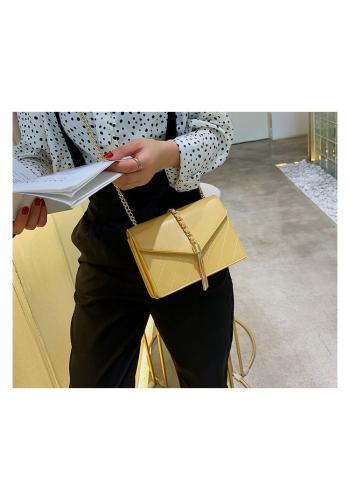 Dámská elegantní kabelka se zlatými doplňky ve žluté barvě
