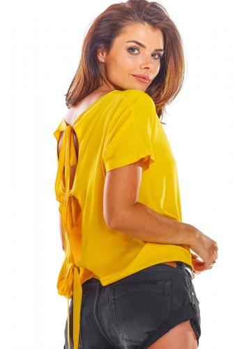 Módní dámská halenka žluté barvy s vázáním na zádech