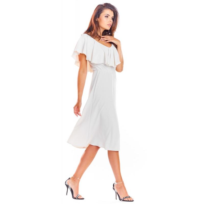 Béžové elegantní šaty s volánem pro dámy