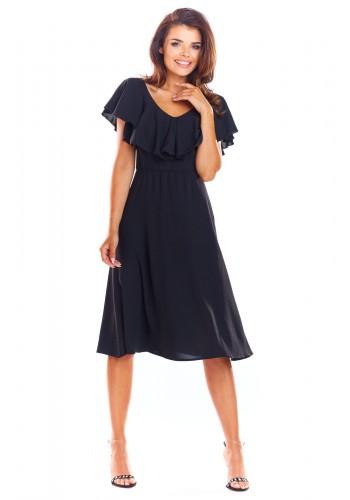 Elegantní dámské šaty černé barvy s volánem