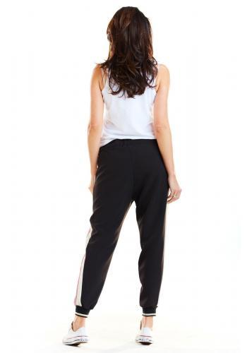 Sportovní dámské kalhoty černé barvy s růžovo-bílými pásy