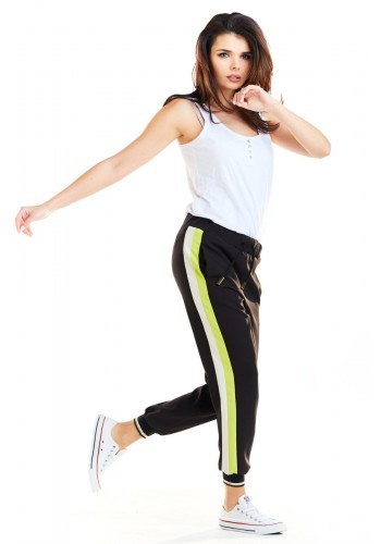 Černé sportovní kalhoty s limetkově-bílými pásy pro dámy