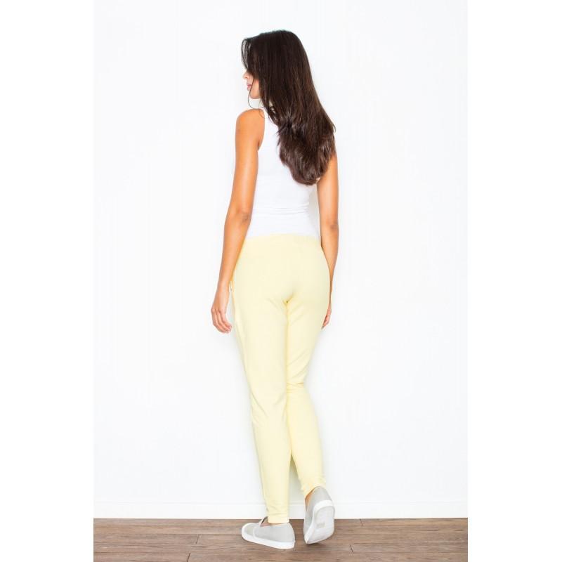 Bavlněné dámské tepláky žluté barvy v jednoduchém střihu
