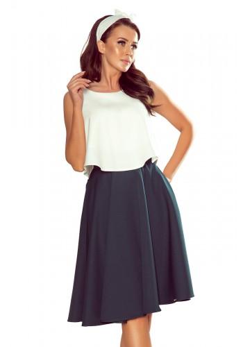 Rozšířená dámská sukně zelené barvy s kapsami