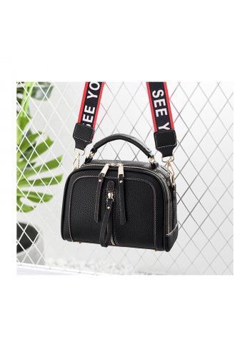 Stylová dámská kabelka černé barvy se zipy