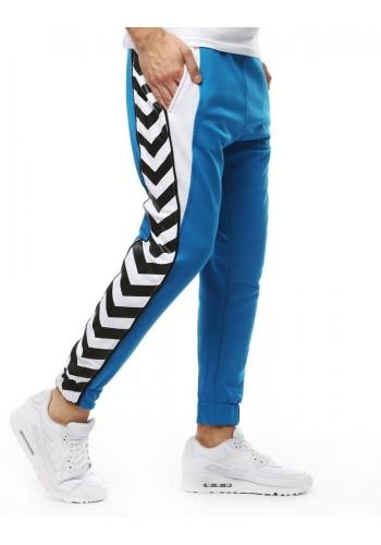 Pánské módní tepláky s potiskem na bocích v modré barvě