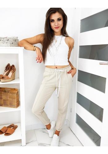 Dámské stylové kalhoty se záhyby v béžové barvě