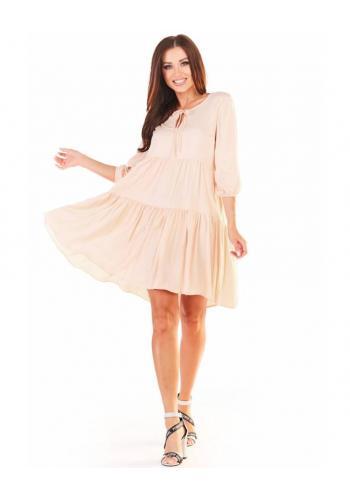 Volné dámské šaty béžové barvy na léto
