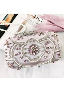 Společenská dámská kabelka stříbrné barvy s krystaly a perlami
