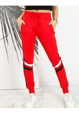 Stylové dámské tepláky červené barvy s kontrastními pruhy