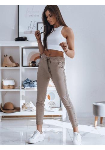 Teplákové dámské kalhoty béžové barvy s pruhem