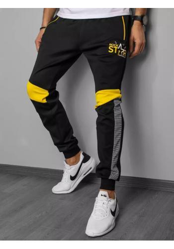 Pánské módní tepláky s potiskem a vložkami v černé barvě