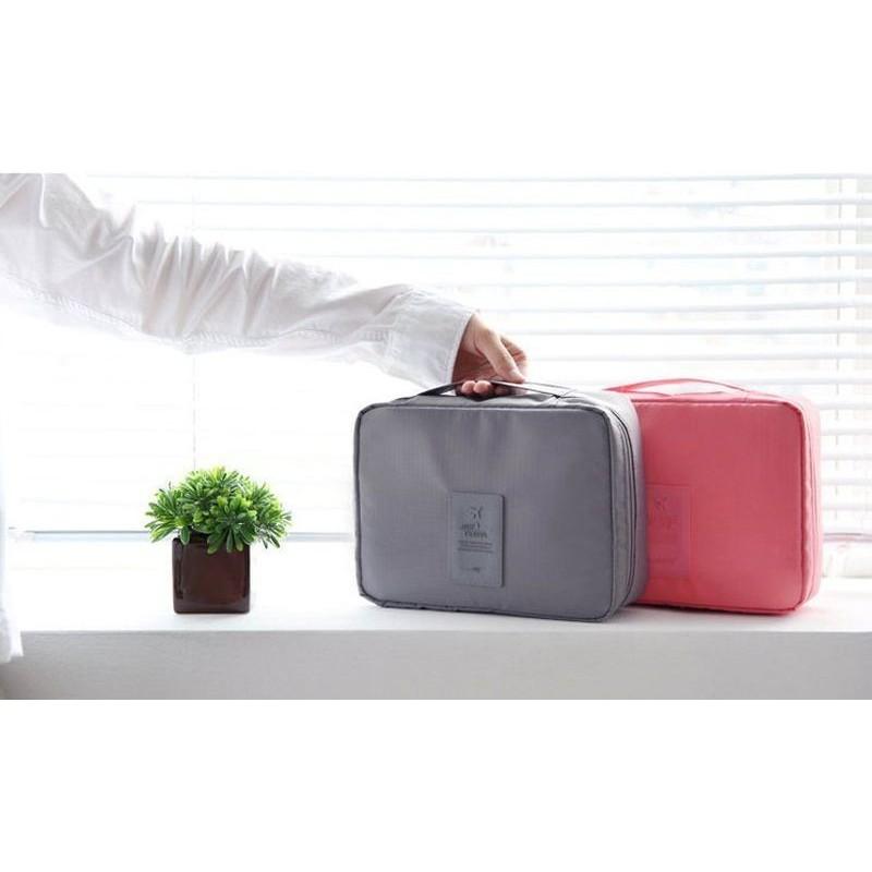 Kosmetická taška růžové barvy s množstvím kapes