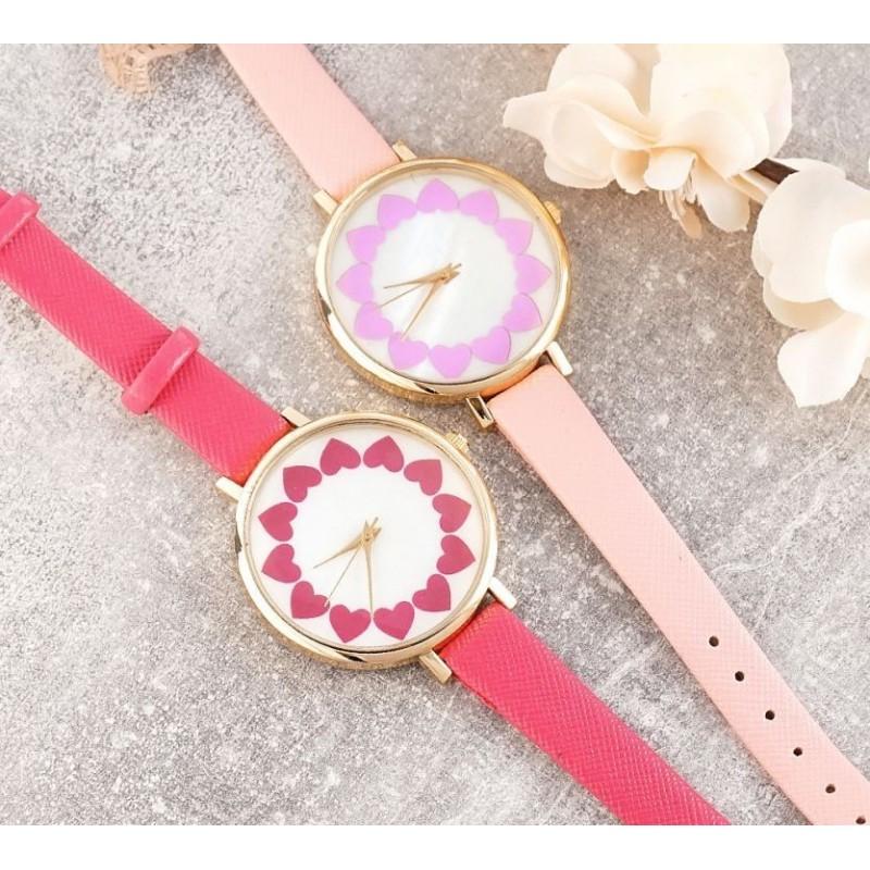 Světle růžové dámské hodinky se srdíčky na ciferníku